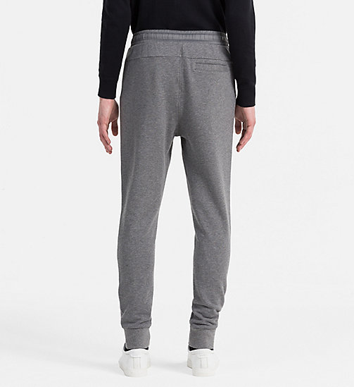 CALVIN KLEIN JEANS Embossed Logo Sweatpants - MID GREY HEATHER - CALVIN KLEIN JEANS 24/7 STAPLES - detail image 1