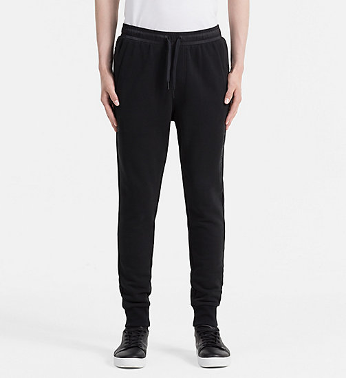 CALVIN KLEIN JEANS Embossed Logo Sweatpants - CK BLACK - CALVIN KLEIN JEANS JOGGING BOTTOMS - main image