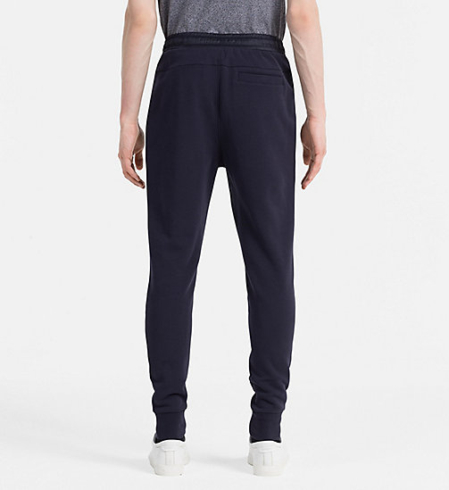 CALVIN KLEIN JEANS Embossed Logo Sweatpants - NIGHT SKY - CALVIN KLEIN JEANS JOGGING BOTTOMS - detail image 1