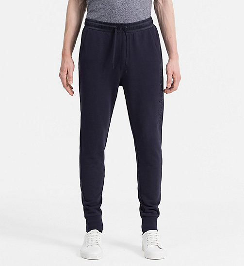 CALVIN KLEIN JEANS Embossed Logo Sweatpants - NIGHT SKY - CALVIN KLEIN JEANS JOGGING BOTTOMS - main image