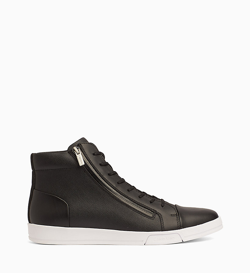 These black and white leather and suede Exton high-top sneakers from Balmain feature contrasting panels, a rubber sole, a zipper fastening on the back, an adjustable lobster clasp at the ankle and a leather band at the front. read more.