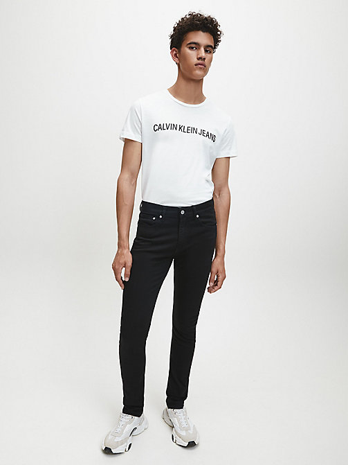 CALVIN KLEIN JEANS CKJ 016 Skinny Jeans - STAY BLACK - CALVIN KLEIN JEANS IN THE THICK OF IT FOR HIM - dettaglio immagine 1