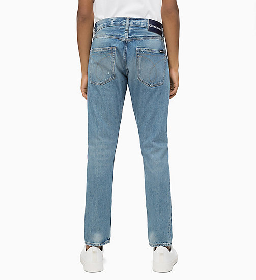 CALVIN KLEIN JEANS CKJ 056 Athletic Tapered Jeans - SHORE BLUE - CALVIN KLEIN JEANS BOLD GRAPHICS - main image 1