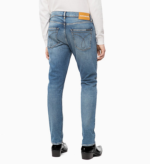 CALVIN KLEIN JEANS CKJ 056 Athletic Tapered Jeans - GERALDTON BLUE - CALVIN KLEIN JEANS BOLD GRAPHICS - main image 1