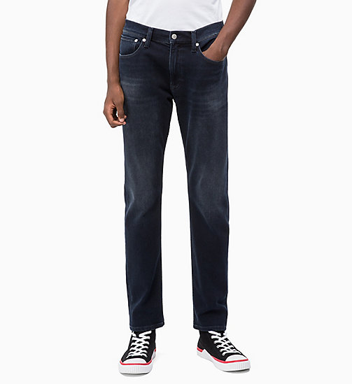 CALVIN KLEIN JEANS CKJ 056 Athletic Taper Jeans - CORELLA BLUE BLACK (BRUSHED) - CALVIN KLEIN JEANS BOLD GRAPHICS - main image