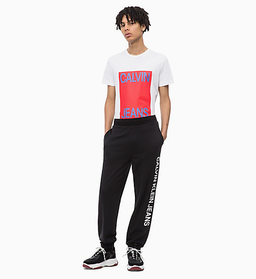 CALVIN KLEIN JEANS Slim Fit Logo-T-Shirt - BRIGHT WHITE / TOMATO - CALVIN KLEIN JEANS BOLD GRAPHICS - main image 1