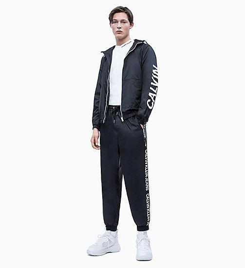 ... CALVIN KLEIN JEANS Veste à capuche en nylon avec logo - CK BLACK - CALVIN  KLEIN 2e2cd0b421ad