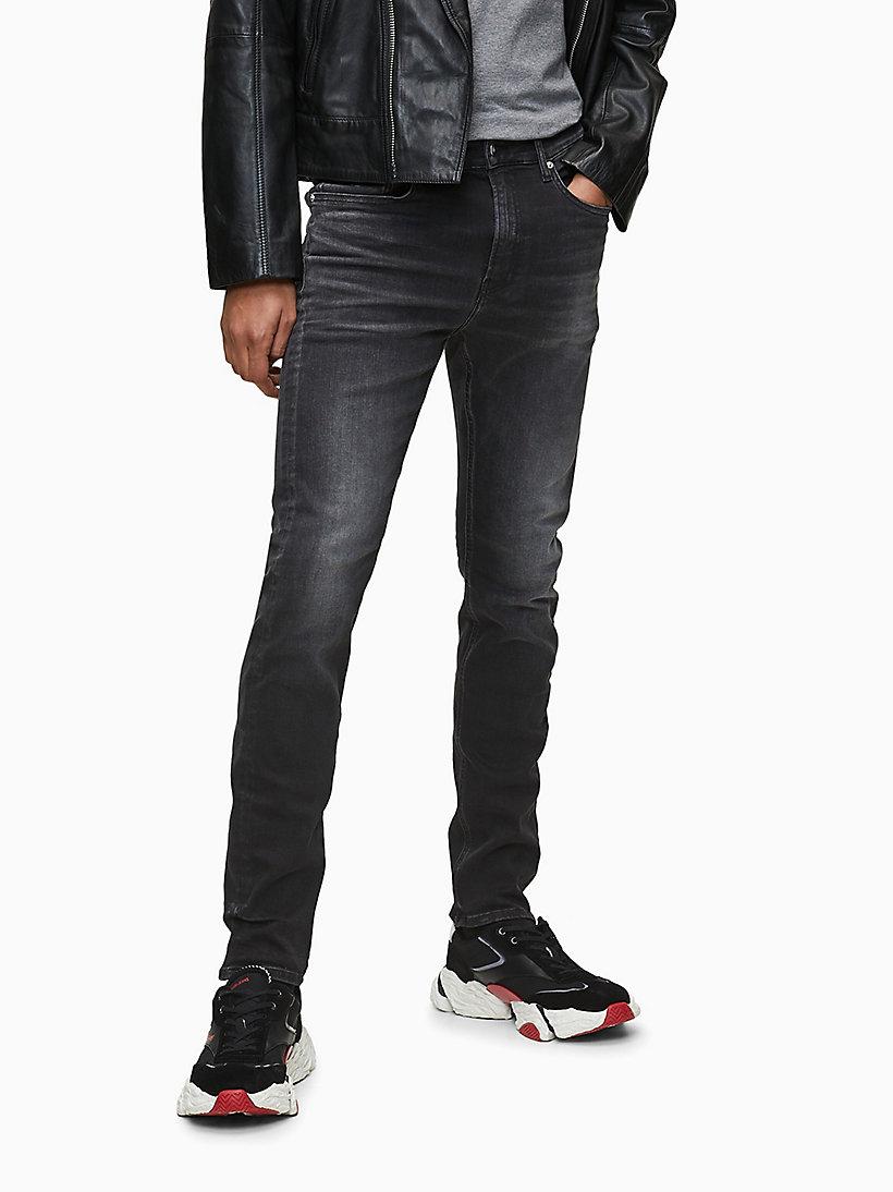 CKJ 058 Slim Tapered Jeans CALVIN KLEIN