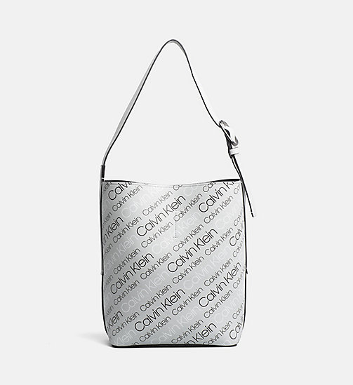 CALVINKLEIN Reversible Bucket Bag - LOGO PRINT/BLACK - CALVIN KLEIN NEW IN - main image
