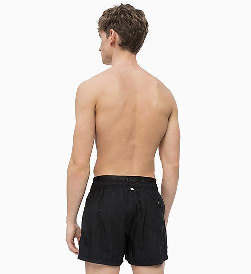 ee1c327c22 Men's Swimwear | Summer Swimwear for Men | CALVIN KLEIN® - Official Site